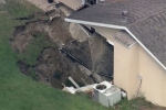 Sink -Hole swallows part of a Florida Home